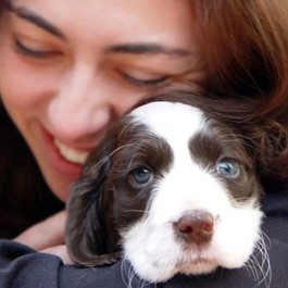 Woman Holding Puppy